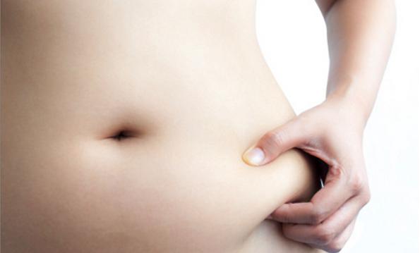 Woman pinching Body Fat