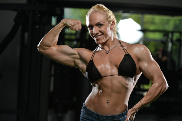 Female Bodybuilder Flexing Bicep