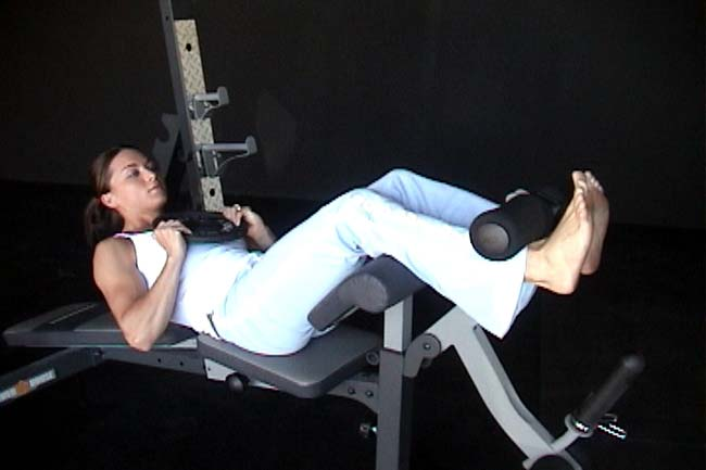 Woman Doi9ng Crunches on Bench