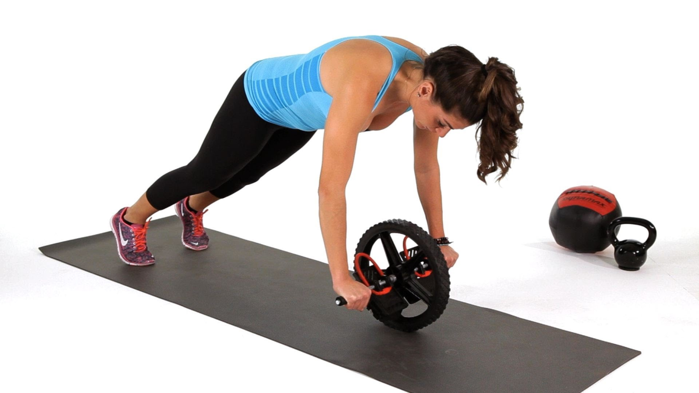 Woman Using Ab Wheel Roller