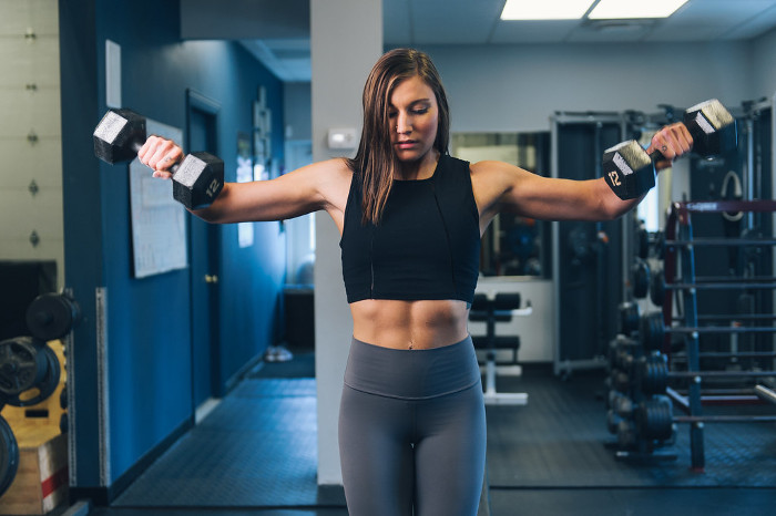 Female Fitness Model Doing Flies